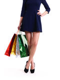 Woman in high heels with color shopping bags. Stock Images