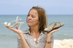 Woman between high heels and health Royalty Free Stock Photo