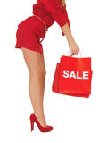 Woman on high heels holding shopping bag Stock Photography