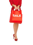 Woman on high heels holding shopping bag Stock Photo