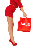Woman on high heels holding shopping bags Stock Image