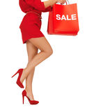 Woman on high heels holding shopping bags Stock Photo