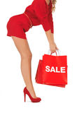 Woman on high heels holding shopping bags Stock Photos