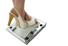 Woman in High Heels on Scale Stock Photo