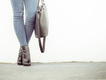 Woman in high heels shoes holds handbag Royalty Free Stock Image