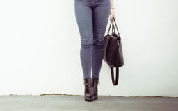 Woman in high heels shoes holds handbag Royalty Free Stock Photos