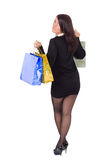 Woman on high heels and short skirt is shopping Stock Images