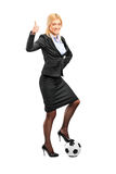 Woman in high heels standing on a ball Stock Photography