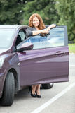 Woman in high heels standing near a new car Stock Photo