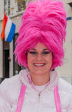 Woman with high pink wig Stock Images