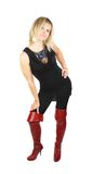 Woman in high red boots. Stock Image