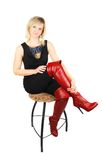 Woman in high red boots. Royalty Free Stock Image