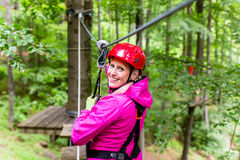 Woman in high rope course or park climbing Stock Image