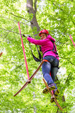 Woman in high rope course or park climbing Royalty Free Stock Image