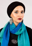 Woman in hijab and colorful scarf. Arabic woman with high fashion make up wearing hijab, colorful scarf and fashion earrings Royalty Free Stock Image