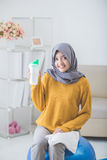Woman with hijab doing exercise at home Royalty Free Stock Images