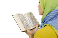 Woman In Hijab Reading Koran. Isolated over white background Royalty Free Stock Photos