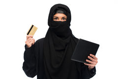 Woman in hijab with tablet pc and credit card Royalty Free Stock Images