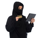 Woman in hijab with tablet pc and credit card Royalty Free Stock Photos