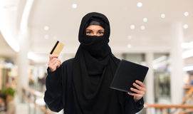Woman in hijab with tablet pc and credit card Stock Photography