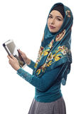 Woman in Hijab Using a Tablet Royalty Free Stock Photo