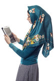 Woman in Hijab Using a Tablet Stock Photo
