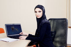 A woman in hijab working on a computer. At the office Royalty Free Stock Images