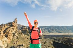 Woman hiker with arms outstretched enjoy mountains Stock Image