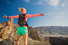 Woman hiker with arms outstretched enjoy mountains Stock Photography