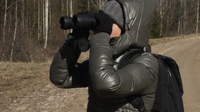 Woman hiker with backpack and binoculars enjoy nature. Stock footage video stock video footage