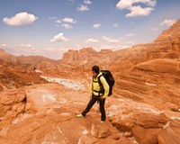 Woman Hiker with backpack enjoy view in desert. Woman mountain Hiker with backpack enjoy view in Sinai desert Royalty Free Stock Photography