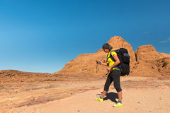 Woman Hiker with backpack and GPS Royalty Free Stock Image