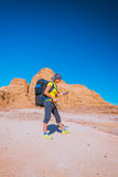 Woman Hiker with backpack and GPS Royalty Free Stock Photo