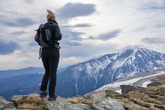 Woman hiker with backpack in the mountains Royalty Free Stock Photography