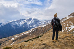 Woman hiker with backpack in the mountains Stock Images