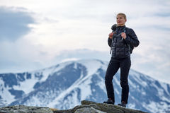 Woman hiker with backpack in the mountains Royalty Free Stock Photo