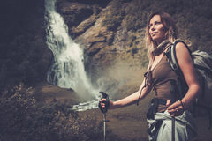 Woman hiker with backpack standing near Vettisfossen waterfall. Royalty Free Stock Photos