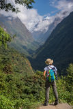 Woman hiker with backpack standing on the rock enjoy mountain view Annapurna ,Nepal. Stock Images