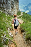Woman hiker with backpack on trail Royalty Free Stock Images