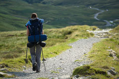 A woman hiker backpacking in the Lake District. Stock Photos