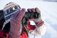Woman hiker with binoculars. Woman hiker looking into big binoculars Stock Photography