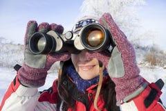 Woman hiker with binoculars. Woman hiker looking into big binoculars Stock Photos