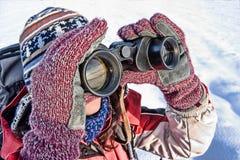 Woman hiker with binoculars. Woman hiker looking into big binoculars. coarse style picture Stock Image