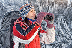 Woman hiker with binoculars. Woman hiker looking into big binoculars Royalty Free Stock Image
