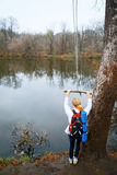 Woman hiker with bungee in the hands near autumn river Stock Photos