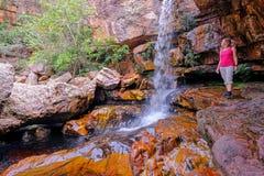 Woman hiker at Cachoeira Da Primavera, Spring Waterfall, Rio Lencois river, Chapada Diamantina National Park, Brazil royalty free stock images