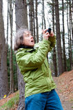 Woman hiker with a camera Royalty Free Stock Photography