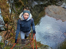 Woman hiker in a canyon. By the river Royalty Free Stock Images