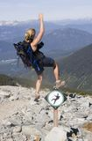 Woman hiker catching herself from fall Royalty Free Stock Image