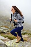 Woman hiker climbing Stock Photography